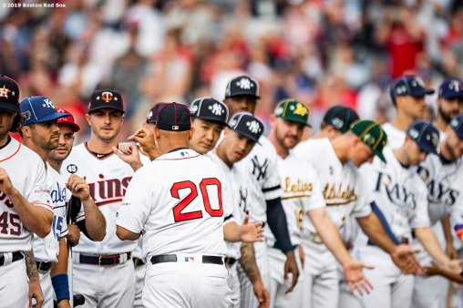 CLEVELAND, OH - JULY 09: Manager Alex Cora of the Boston Red Sox high fives teammates as he is introduced before the 2019 Major League Baseball All-Star Game at Progressive Field on July 9, 2019 in Cleveland, Ohio. (Photo by Billie Weiss/Boston Red Sox/Getty Images) *** Local Caption *** Alex Cora