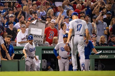 BOSTON, MA - JULY 13: A fan displays a sign as Joe Kelly #17 of the Los Angeles Dodgers walks off the field during the sixth inning of a game against the Boston Red Sox on July 13, 2019 at Fenway Park in Boston, Massachusetts. (Photo by Billie Weiss/Boston Red Sox/Getty Images) *** Local Caption *** Joe Kelly