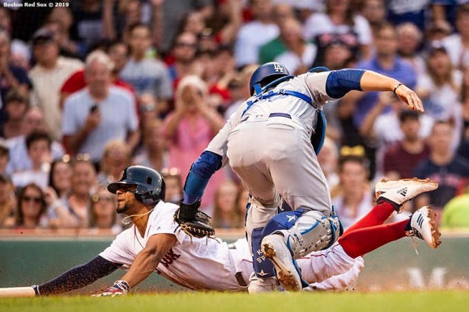 BOSTON, MA - JULY 14: Xander Bogaerts #2 of the Boston Red Sox slides as he evades the tag of Austin Barnes #15 of the Los Angeles Dodgers as he scores during the first inning of a game on July 14, 2019 at Fenway Park in Boston, Massachusetts. (Photo by Billie Weiss/Boston Red Sox/Getty Images) *** Local Caption *** Xander Bogaerts; Austin Barnes