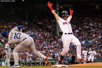 BOSTON, MA - JULY 14: Andrew Benintendi #16 of the Boston Red Sox evades the tag of David Freese #25 of the Los Angeles Dodgers as he beats out an RBI single during the first inning of a game on July 14, 2019 at Fenway Park in Boston, Massachusetts. (Photo by Billie Weiss/Boston Red Sox/Getty Images) *** Local Caption *** Andrew Benintendi; David Freese