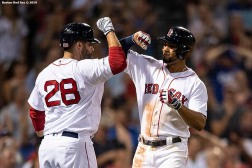 BOSTON, MA - JULY 14: Xander Bogaerts #2 of the Boston Red Sox reacts with J.D. Martinez #28 after hitting a solo home run during the eighth inning of a game against the Los Angeles Dodgers on July 14, 2019 at Fenway Park in Boston, Massachusetts. (Photo by Billie Weiss/Boston Red Sox/Getty Images) *** Local Caption *** Xander Bogaerts; J.D. Martinez
