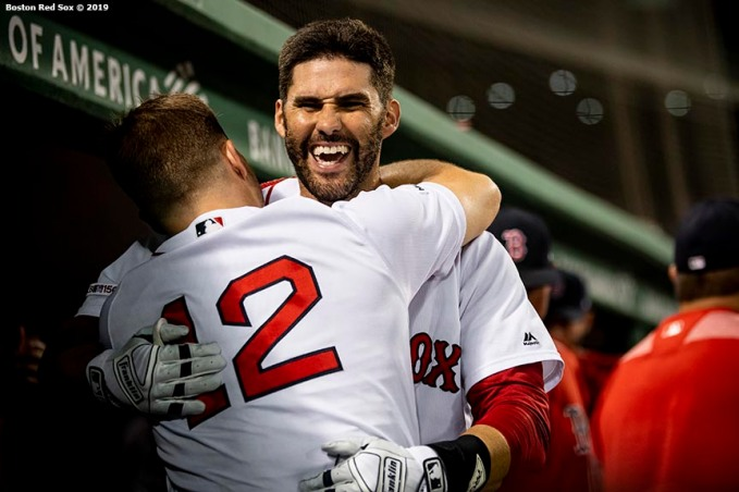 BOSTON, MA - JULY 14: J.D. Martinez #28 of the Boston Red Sox hugs Brock Holt #12 after hitting a game tying solo home run during the eighth inning of a game against the Los Angeles Dodgers on July 14, 2019 at Fenway Park in Boston, Massachusetts. (Photo by Billie Weiss/Boston Red Sox/Getty Images) *** Local Caption *** J.D. Martinez; Brock Holt