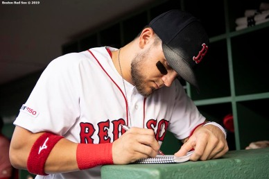 BOSTON, MA - JULY 15: Michael Chavis #23 of the Boston Red Sox writes in his notebook before a game against the Toronto Blue Jays on July 15, 2019 at Fenway Park in Boston, Massachusetts. (Photo by Billie Weiss/Boston Red Sox/Getty Images) *** Local Caption *** Michael Chavis