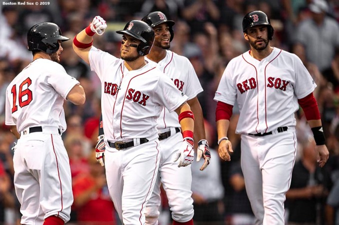 BOSTON, MA - JULY 15: Michael Chavis #23 of the Boston Red Sox reacts with Andrew Benintendi #16, Xander Bogaerts #2, and J.D. Martinez #28 after hitting a grand slam home run during the first inning of a game against the Toronto Blue Jays on July 15, 2019 at Fenway Park in Boston, Massachusetts. (Photo by Billie Weiss/Boston Red Sox/Getty Images) *** Local Caption *** Michael Chavis; Andrew Benintendi; Xander Bogaerts; J.D. Martinez