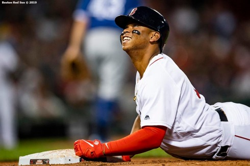 BOSTON, MA - JULY 15: Rafael Devers #11 of the Boston Red Sox reacts after hitting an RBI single during the third inning of a game against the Toronto Blue Jays on July 15, 2019 at Fenway Park in Boston, Massachusetts. (Photo by Billie Weiss/Boston Red Sox/Getty Images) *** Local Caption *** Rafael Devers