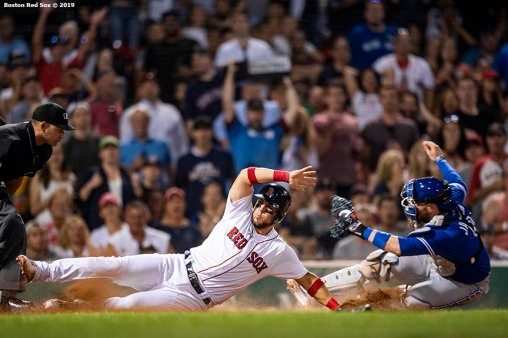 BOSTON, MA - JULY 15: Michael Chavis #23 of the Boston Red Sox is tagged out by Danny Jansen #9 of the Toronto Blue Jays during the sixth inning of a game on July 15, 2019 at Fenway Park in Boston, Massachusetts. (Photo by Billie Weiss/Boston Red Sox/Getty Images) *** Local Caption *** Michael Chavis; Danny Jansen