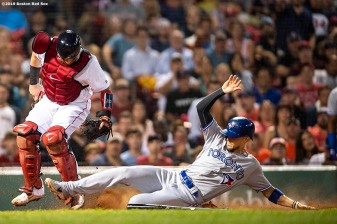 BOSTON, MA - JULY 17: Christian Vazquez #7 of the Boston Red Sox tags out Cavan Biggio #8 of the Toronto Blue Jays during the seventh inning of a game on July 17, 2019 at Fenway Park in Boston, Massachusetts. (Photo by Billie Weiss/Boston Red Sox/Getty Images) *** Local Caption *** Christian Vazquez; Cavan Biggio