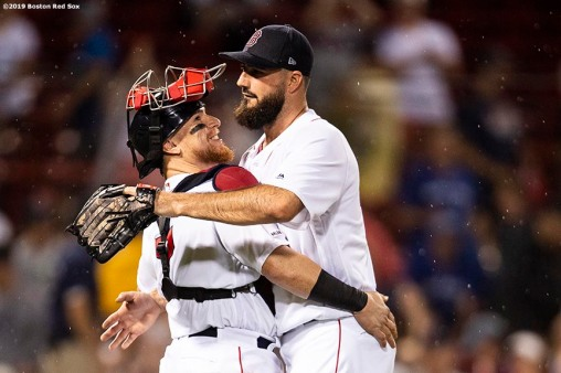 BOSTON, MA - JULY 17: Brandon Workman #44 of the Boston Red Sox hugs Christian Vazquez #7 after a victory against the Toronto Blue Jays on July 17, 2019 at Fenway Park in Boston, Massachusetts. (Photo by Billie Weiss/Boston Red Sox/Getty Images) *** Local Caption *** Brandon Workman; Christian Vazquez