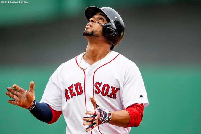 BOSTON, MA - JULY 18: Xander Bogaerts #2 of the Boston Red Sox reacts after hitting a single during the first inning of a game against the Toronto Blue Jays on July 18, 2019 at Fenway Park in Boston, Massachusetts. (Photo by Billie Weiss/Boston Red Sox/Getty Images) *** Local Caption *** Xander Bogaerts