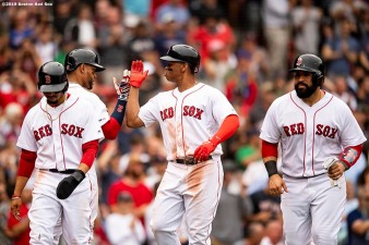 BOSTON, MA - JULY 18: Rafael Devers #11 of the Boston Red Sox high fives Xander Bogaerts #2 after hitting a three run home run during the fifth inning of a game against the Toronto Blue Jays on July 18, 2019 at Fenway Park in Boston, Massachusetts. (Photo by Billie Weiss/Boston Red Sox/Getty Images) *** Local Caption *** Rafael Devers; Xander Bogaerts
