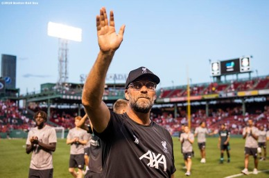 BOSTON, MA - JULY 21: Coach Jürgen Klopp of Liverpool waves to fans after a pre-season friendly match against Sevilla F.C. on July 21, 2019 at Fenway Park in Boston, Massachusetts. (Photo by Billie Weiss/Boston Red Sox/Getty Images) *** Local Caption *** Jürgen Klopp