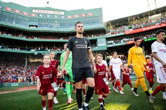 BOSTON, MA - JULY 21: Members of Liverpool and Sevilla F.C. are introduced before a pre-season friendly match on July 21, 2019 at Fenway Park in Boston, Massachusetts. (Photo by Billie Weiss/Boston Red Sox/Getty Images) *** Local Caption ***