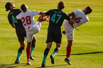 BOSTON, MA - JULY 21: Virgil van Dijk #4 and Nathaniel Phillips #47 of Liverpool fight for a ball with Carrico #6 of Sevilla F.C. during the first half of a pre-season friendly match on July 21, 2019 at Fenway Park in Boston, Massachusetts. (Photo by Billie Weiss/Boston Red Sox/Getty Images) *** Local Caption *** Virgil van Dijk; Carrico; Nathaniel Phillips