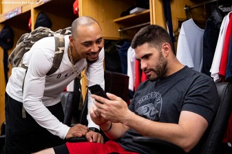 BOSTON, MA - JULY 25: Mookie Betts #50 and J.D. Martinez #28 of the Boston Red Sox look at a phone before a game against the New York Yankees on July 25, 2019 at Fenway Park in Boston, Massachusetts. (Photo by Billie Weiss/Boston Red Sox/Getty Images) *** Local Caption *** J.D. Martinez; Mookie Betts