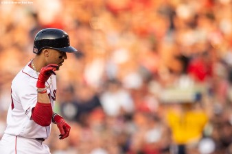 BOSTON, MA - JULY 25: Mookie Betts #50 of the Boston Red Sox reacts after hitting a single during the first inning of a game against the New York Yankees on July 25, 2019 at Fenway Park in Boston, Massachusetts. (Photo by Billie Weiss/Boston Red Sox/Getty Images) *** Local Caption *** Mookie Betts