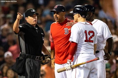 BOSTON, MA - JULY 25: Manager Alex Cora of the Boston Red Sox and Brock Holt #12 argue with home plate umpire D.J. Reyburn after he ejected Holt from the game after being called out on strikes during the third inning of a game against the New York Yankees on July 25, 2019 at Fenway Park in Boston, Massachusetts. (Photo by Billie Weiss/Boston Red Sox/Getty Images) *** Local Caption *** Brock Holt; D.J. Reyburn; Alex Cora