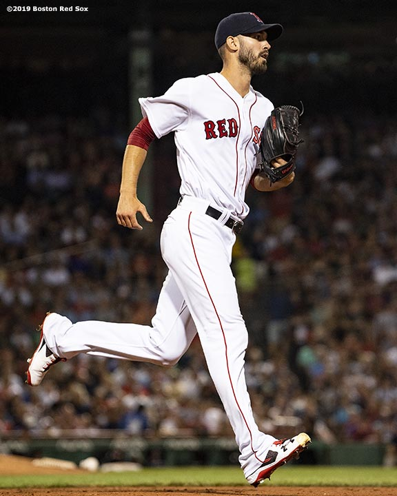 BOSTON, MA - JULY 25: Rick Porcello #22 of the Boston Red Sox reacts as he covers first base during the fifth inning of a game against the New York Yankees on July 25, 2019 at Fenway Park in Boston, Massachusetts. (Photo by Billie Weiss/Boston Red Sox/Getty Images) *** Local Caption *** Rick Porcello
