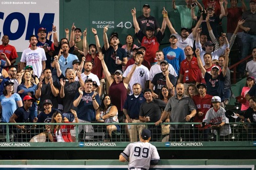 BOSTON, MA - JULY 25: Fans react as Aaron Judge #99 watches a home run ball hit by Sandy Leon #3 of the Boston Red Sox during the eighth inning of a game on July 25, 2019 at Fenway Park in Boston, Massachusetts. (Photo by Billie Weiss/Boston Red Sox/Getty Images) *** Local Caption *** Aaron Judge