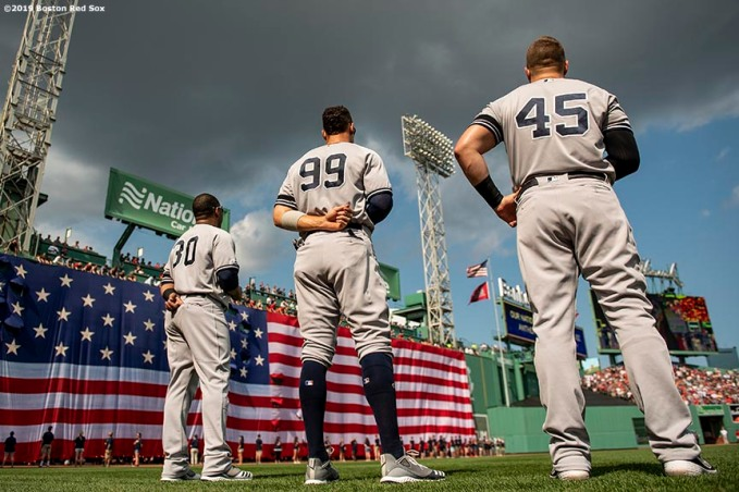BOSTON, MA - JULY 27: Aaron Judge #99 of the New York Yankees looks on as the American flag is dropped over the Green Monster before a game against the Boston Red Sox on July 27, 2019 at Fenway Park in Boston, Massachusetts. (Photo by Billie Weiss/Boston Red Sox/Getty Images) *** Local Caption *** Aaron Judge