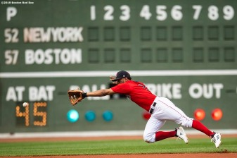 BOSTON, MA - JULY 27: Xander Bogaerts #2 of the Boston Red Sox dives for a ball during the first inning of a game against the New York Yankees on July 27, 2019 at Fenway Park in Boston, Massachusetts. (Photo by Billie Weiss/Boston Red Sox/Getty Images) *** Local Caption *** Xander Bogaerts