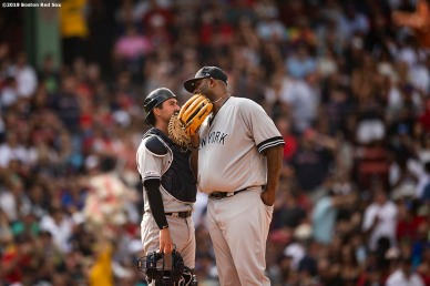 BOSTON, MA - JULY 27: CC Sabathia #52 of the New York Yankees talks with Kyle Higashioka #66 during the second inning of a game against the Boston Red Sox on July 27, 2019 at Fenway Park in Boston, Massachusetts. (Photo by Billie Weiss/Boston Red Sox/Getty Images) *** Local Caption *** CC Sabathia; Kyle Higashioka
