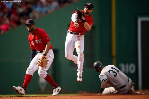 BOSTON, MA - JULY 27: Michael Chavis #23 of the Boston Red Sox turns an unassisted double play alongside Xander Bogaerts #2 over Aaron Hicks #31 of the New York Yankees during the third inning of a game on July 27, 2019 at Fenway Park in Boston, Massachusetts. (Photo by Billie Weiss/Boston Red Sox/Getty Images) *** Local Caption *** Michael Chavis; Aaron Hicks; Xander Bogaerts