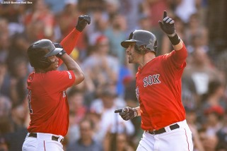 BOSTON, MA - JULY 27: J.D. Martinez #2 of the Boston Red Sox reacts with Rafael Devers #11 after hitting a two run home run during the fourth inning of a game against the New York Yankees on July 27, 2019 at Fenway Park in Boston, Massachusetts. (Photo by Billie Weiss/Boston Red Sox/Getty Images) *** Local Caption *** J.D. Martinez; Rafael Devers