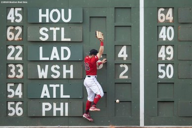 BOSTON, MA - JULY 27: Andrew Benintendi #16 of the Boston Red Sox attempts to catch a fly ball during the fifth inning of a game against the New York Yankees on July 27, 2019 at Fenway Park in Boston, Massachusetts. (Photo by Billie Weiss/Boston Red Sox/Getty Images) *** Local Caption *** Andrew Benintendi