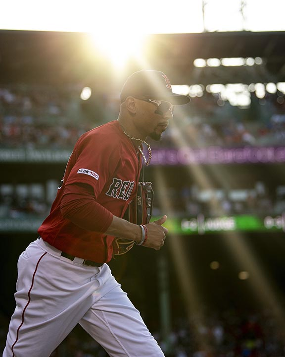 BOSTON, MA - JULY 27: Mookie Betts #50 of the Boston Red Sox runs onto the field during the seventh inning of a game against the New York Yankees on July 27, 2019 at Fenway Park in Boston, Massachusetts. (Photo by Billie Weiss/Boston Red Sox/Getty Images) *** Local Caption *** Mookie Betts