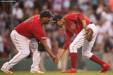 BOSTON, MA - JULY 27: Rafael Devers #11 and Mookie Betts #50 of the Boston Red Sox celebrate a victory against the New York Yankees on July 27, 2019 at Fenway Park in Boston, Massachusetts. (Photo by Billie Weiss/Boston Red Sox/Getty Images) *** Local Caption *** Rafael Devers; Mookie Betts