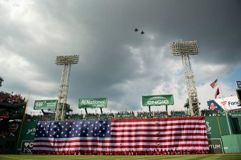 BOSTON, MA - JULY 27: A flyover is held as the American flag is dropped over the Green Monster before a game between the Boston Red Sox the New York Yankees on July 27, 2019 at Fenway Park in Boston, Massachusetts. (Photo by Billie Weiss/Boston Red Sox/Getty Images) *** Local Caption ***