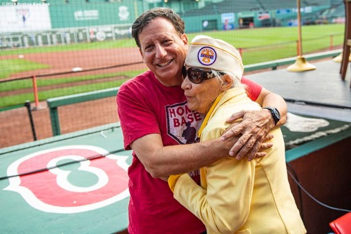 July 27, 2019 , Boston, MA: Boston Red Sox Chairman Tom Werner hugs a gold star wife during the 2019 Run to Home Base presented by New Balance at Fenway Park in Boston, Massachusetts Saturday, July 27, 2019. (Photo by Billie Weiss/Home Base)