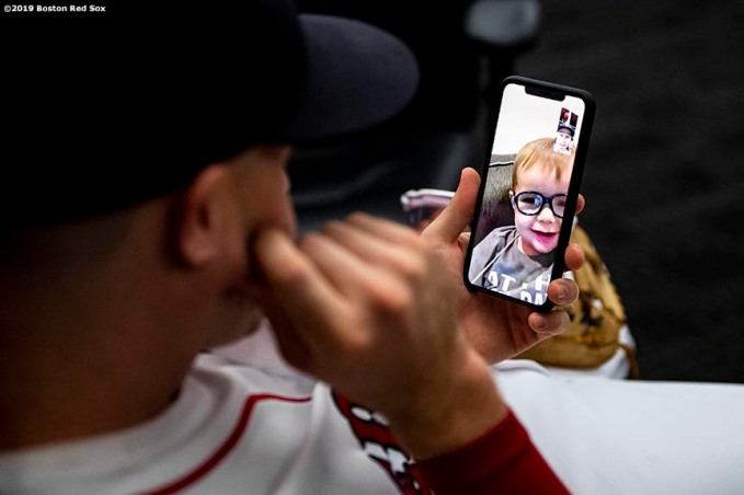 BOSTON, MA - JULY 31: Brock Holt #12 of the Boston Red Sox face times his son Griff before a game against the Tampa Bay Rays on July 31, 2019 at Fenway Park in Boston, Massachusetts. (Photo by Billie Weiss/Boston Red Sox/Getty Images) *** Local Caption *** Brock Holt