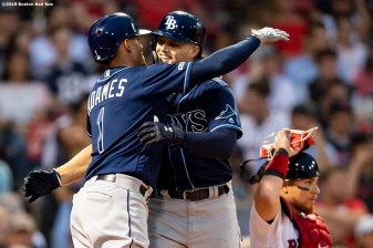BOSTON, MA - JULY 31: Austin Meadows #17 hugs Willy Adames #1 of the Tampa Bay Rays after hitting a two run home run during the second inning of a game against the Boston Red Sox on July 31, 2019 at Fenway Park in Boston, Massachusetts. (Photo by Billie Weiss/Boston Red Sox/Getty Images) *** Local Caption *** Austin Meadows; Willy Adames