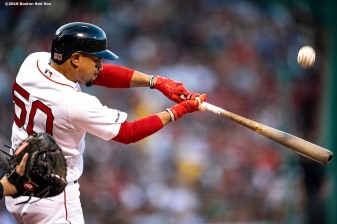 BOSTON, MA - AUGUST 1: Mookie Betts #50 of the Boston Red Sox hits a single during the first inning of a game against the Tampa Bay Rays on August 1, 2019 at Fenway Park in Boston, Massachusetts. (Photo by Billie Weiss/Boston Red Sox/Getty Images) *** Local Caption *** Mookie Betts