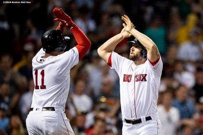BOSTON, MA - AUGUST 5: Sam Travis #59 of the Boston Red Sox high fives Rafael Devers #11 after hitting a two run home run during the third inning of a game against the Kansas City Royals on August 5, 2019 at Fenway Park in Boston, Massachusetts. (Photo by Billie Weiss/Boston Red Sox/Getty Images) *** Local Caption *** Sam Travis; Rafael Devers