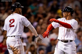 BOSTON, MA - AUGUST 5: Rafael Devers #11 of the Boston Red Sox reacts with Xander Bogaerts #2 after hitting a solo home run during the fifth inning of a game against the Kansas City Royals on August 5, 2019 at Fenway Park in Boston, Massachusetts. (Photo by Billie Weiss/Boston Red Sox/Getty Images) *** Local Caption *** Rafael Devers; Xander Bogaerts