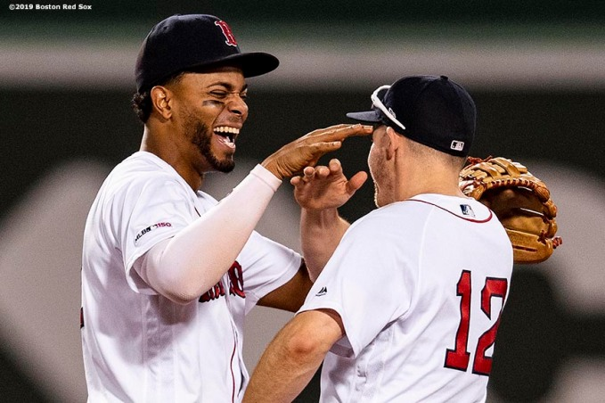 BOSTON, MA - AUGUST 5: Xander Bogaerts #2 and Brock Holt #12 of the Boston Red Sox celebrate a victory against the Kansas City Royals on August 5, 2019 at Fenway Park in Boston, Massachusetts. (Photo by Billie Weiss/Boston Red Sox/Getty Images) *** Local Caption *** Xander Bogaerts; Brock Holt