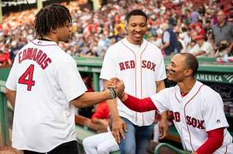 BOSTON, MA - AUGUST 5: Mookie Betts #50 of the Boston Red Sox greets Carsen Edwards #4 and Grant Williams #40 of the Boston Celtics before they throw out a ceremonial first pitch before a game against the Kansas City Royals on August 6, 2019 at Fenway Park in Boston, Massachusetts. (Photo by Billie Weiss/Boston Red Sox/Getty Images) *** Local Caption *** Mookie Betts; Carsen Edwards; Grant Williams