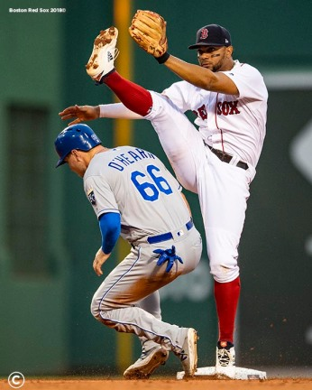 BOSTON, MA - AUGUST 7: Xander Bogaerts #2 of the Boston Red Sox throws to first base as he attempts to turn a double play over Ryan O'Hearn #66 of the Kansas City Royals during the second inning of a game on August 7, 2019 at Fenway Park in Boston, Massachusetts. (Photo by Billie Weiss/Boston Red Sox/Getty Images) *** Local Caption *** Xander Bogaerts; Ryan O'Hearn