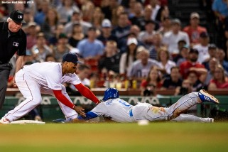 BOSTON, MA - AUGUST 7: Rafael Devers #11 of the Boston Red Sox tags out Billy Hamilton #6 of the Kansas City Royals as he attempts to tag up at third base during the fourth inning of a game on August 7, 2019 at Fenway Park in Boston, Massachusetts. (Photo by Billie Weiss/Boston Red Sox/Getty Images) *** Local Caption *** Rafael Devers; Billy Hamilton