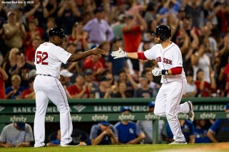 BOSTON, MA - AUGUST 7: J.D. Martinez #28 of the Boston Red Sox high fives Carlos Febles #52 after hitting a game tying two run home run during the fourth inning of a game against the Kansas City Royals on August 7, 2019 at Fenway Park in Boston, Massachusetts. (Photo by Billie Weiss/Boston Red Sox/Getty Images) *** Local Caption *** J.D. Martinez; Carlos Febles