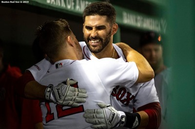 BOSTON, MA - AUGUST 7: J.D. Martinez #28 of the Boston Red Sox hugs Brock Holt #12 after hitting a game tying two run home run during the fourth inning of a game against the Kansas City Royals on August 7, 2019 at Fenway Park in Boston, Massachusetts. (Photo by Billie Weiss/Boston Red Sox/Getty Images) *** Local Caption *** J.D. Martinez; Brock Holt