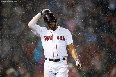 BOSTON, MA - AUGUST 7: Xander Bogaerts #2 of the Boston Red Sox reacts after flying out as rain falls during the ninth inning of a game against the Kansas City Royals on August 7, 2019 at Fenway Park in Boston, Massachusetts. (Photo by Billie Weiss/Boston Red Sox/Getty Images) *** Local Caption *** Xander Bogaerts
