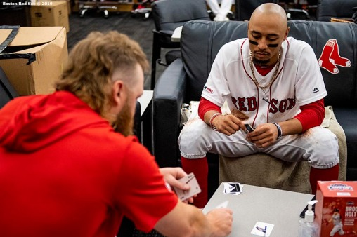 BOSTON, MA - AUGUST 7: Andrew Cashner #48 and Mookie Betts #50 of the Boston Red Sox play cards during a rain delay during a game against the Kansas City Royals on August 7, 2019 at Fenway Park in Boston, Massachusetts. (Photo by Billie Weiss/Boston Red Sox/Getty Images) *** Local Caption *** Andrew Cashner; Mookie Betts