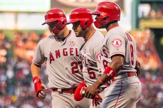 BOSTON, MA - AUGUST 9: Albert Pujols #5 of the Los Angeles Angels of Anaheim reacts with Mike Trout #27 and Justin Upton #8 after hitting a three run home run during the first inning of a game against the Boston Red Sox on August 9, 2019 at Fenway Park in Boston, Massachusetts. (Photo by Billie Weiss/Boston Red Sox/Getty Images) *** Local Caption *** Albert Pujols; Justin Upton; Mike Trout