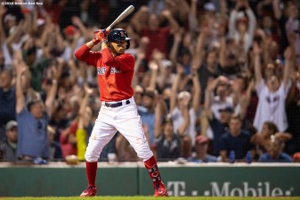 BOSTON, MA - AUGUST 9: Mookie Betts #50 of the Boston Red Sox bats as fans do the wave during the seventh inning of a game against the Los Angeles Angels of Anaheim on August 9, 2019 at Fenway Park in Boston, Massachusetts. (Photo by Billie Weiss/Boston Red Sox/Getty Images) *** Local Caption *** Mookie Betts