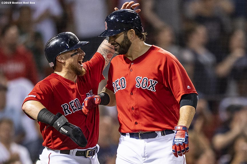 BOSTON, MA - AUGUST 9: Mitch Moreland #18 of the Boston Red Sox reacts with Christian Vazquez #7 after hitting a two run home run during the eighth inning of a game against the Los Angeles Angels of Anaheim on August 9, 2019 at Fenway Park in Boston, Massachusetts. (Photo by Billie Weiss/Boston Red Sox/Getty Images) *** Local Caption *** Mitch Moreland; Christian Vazquez