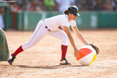 BOSTON, MA - AUGUST 10: The ball girl removes a beach ball from the field during a game between the Boston Red Sox and the Los Angeles Angels of Anaheim on August 10, 2019 at Fenway Park in Boston, Massachusetts. (Photo by Billie Weiss/Boston Red Sox/Getty Images) *** Local Caption ***