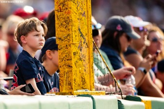 BOSTON, MA - AUGUST 10: A young fan looks on during a game between the Boston Red Sox and the Los Angeles Angels of Anaheim on August 10, 2019 at Fenway Park in Boston, Massachusetts. (Photo by Billie Weiss/Boston Red Sox/Getty Images) *** Local Caption ***
